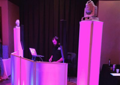 Wedding DJ Under Pink Lighting